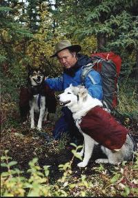 Ned Cathers with a couple of his Husky pack dogs in the Yukon